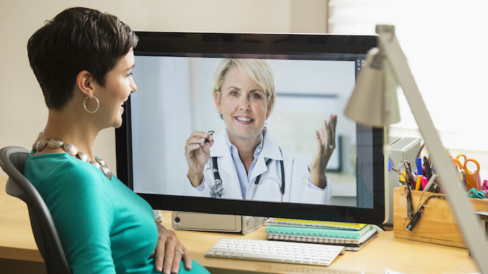 Woman on an e-visit with telemedicine provider